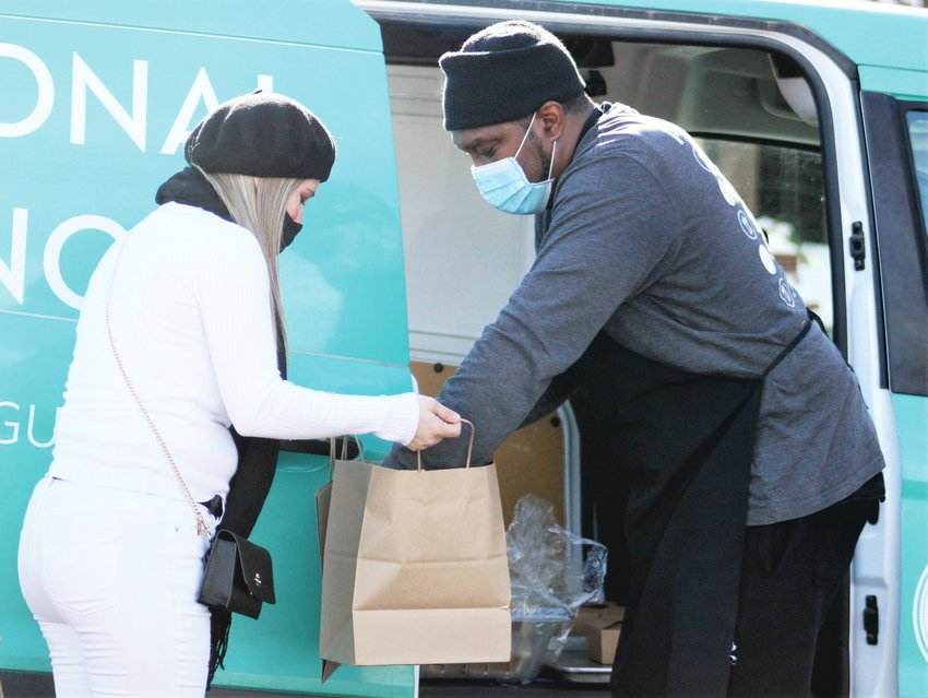 Arvada resident Kimber Just, left, organized the lunch delivery. Just had previously delivered lunches in past years, but, with the help of Councilmember Lauren Simpson, was able to coordinate delivery this year with the help of a pair of catering companies. (Michael Hicks)