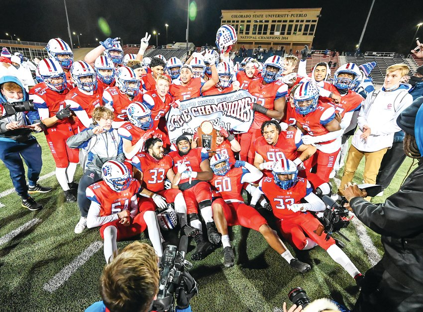 The Cherry Creek Bruins celebrate their repeat performance as 5A state champions by defeating Valor Christian 21-0 in the 5A state final Dec. 5 at the CSU Pueblo Thunderbowl.