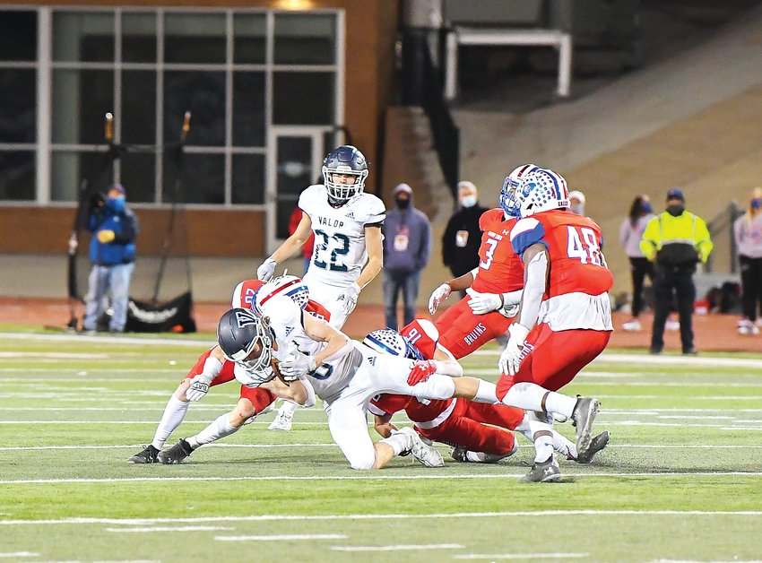 Valor Christian's Tyler Larson (6) gets pulled to the ground by Cherry Creek defenders Sam Pezdirtz (26) and Austin Luhring (16) as teammates Jaxson Hurd (48) and Myles Purchase close in to help.