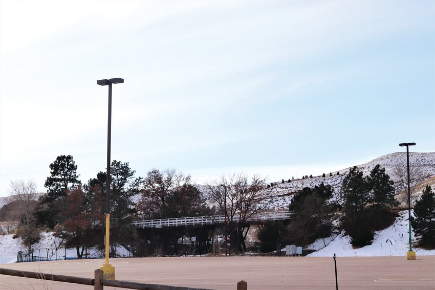 A view of a parking lot for Heritage Square as well as the old train trestle bridge on the property, one of the last remaining vestiges of the old amusement park.