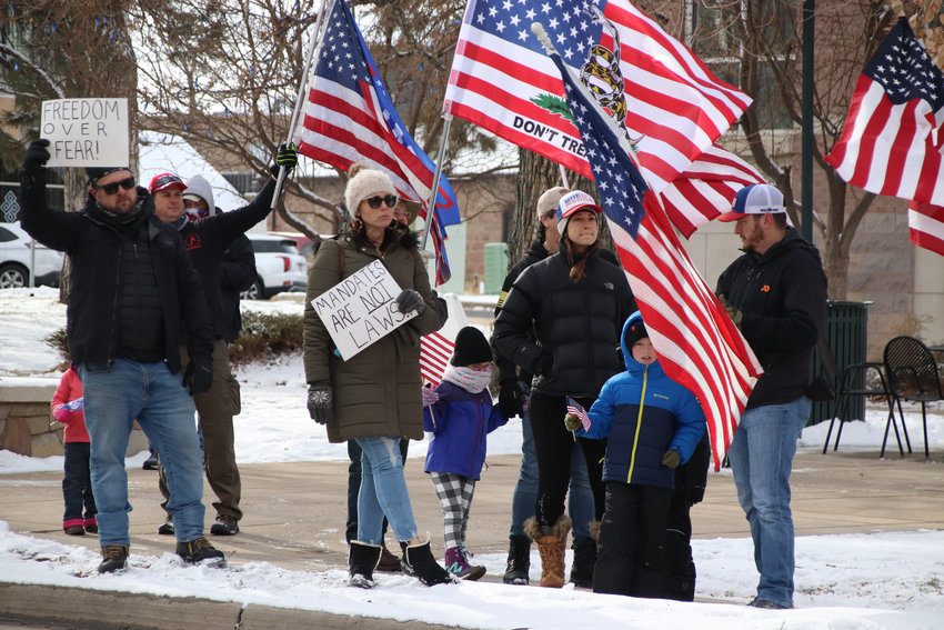 Protesters rallied against restrictions placed on local businesses in Castle Rock on Dec. 12.