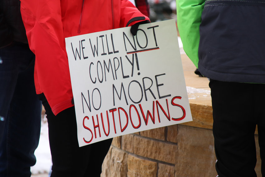 "People at the rally chanted ""Freedom over fear"" and called for an end to shutdowns as they marched downtown."