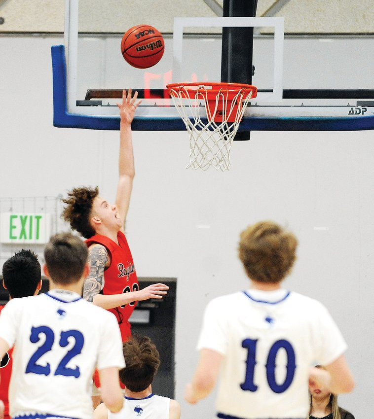 Brighton's Blake Ferguson goes for the layup against Broomfield during the Class 5A first round of playoff action Feb. 26 at Broomfield High School.