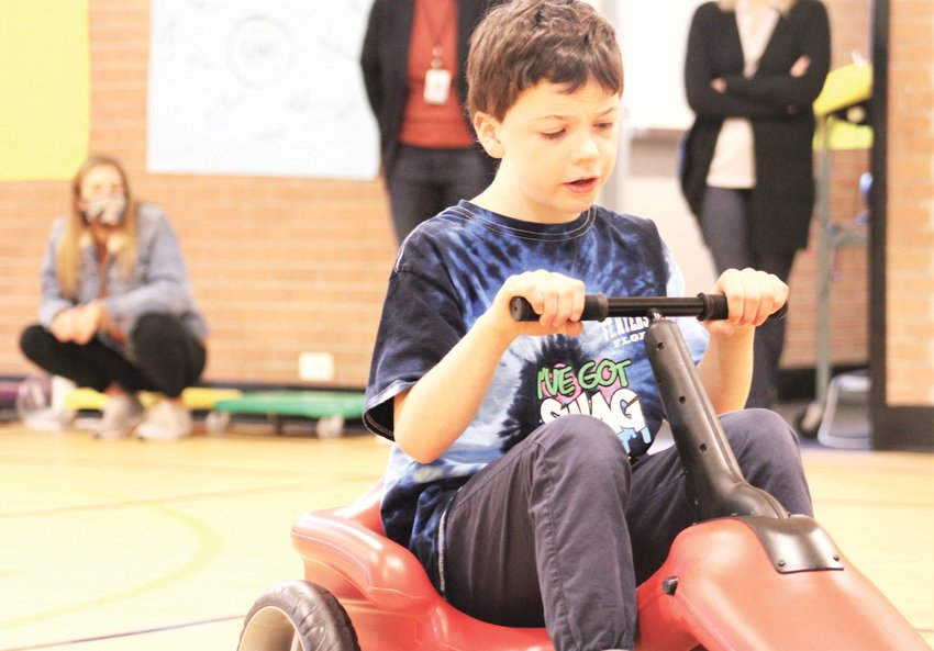 Luke Martin was one of nearly a dozen Fitzmorris Elementary School students who are in the school's Autism Spectrum Disorder program to show off the school's Pumper Car.