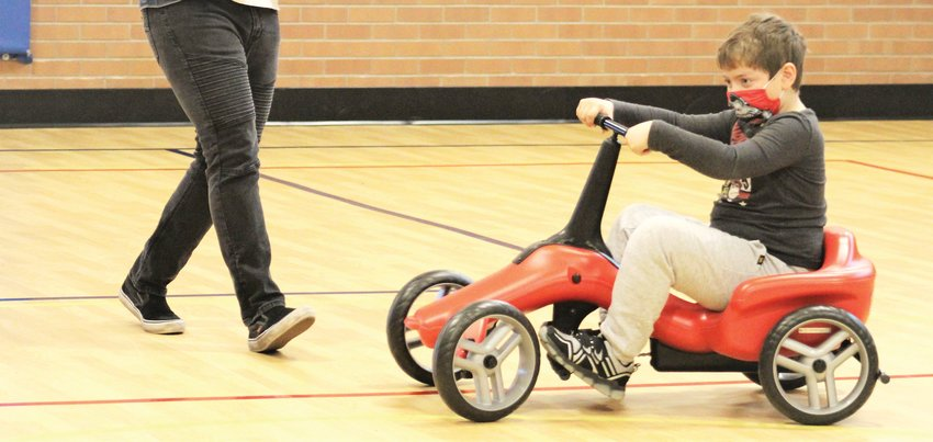 Fitzmorris Elementary School student Dalton Minor takes a spin around the school's gymnasium on the Pumper Car.