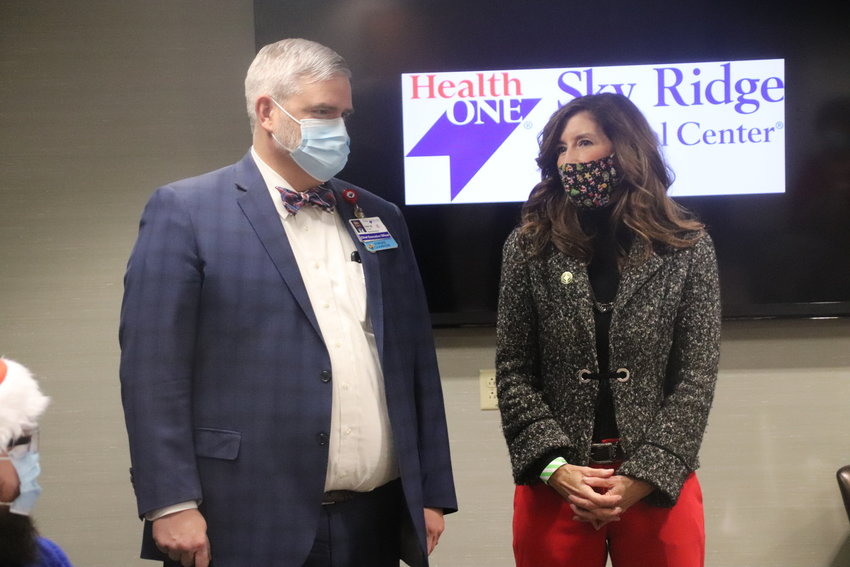 Sky Ridge Medical Center CEO Kirk McCarty, left, and Lone Tree Mayor Jackie Millet speak prior to the hospital administering the first shots of COVID-19 Dec. 16.