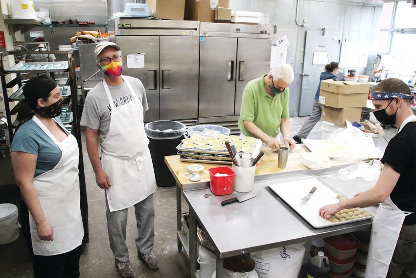 At Trompeau Bakery in Englewood, head bread baker Rande Smith, second from left, said good ingredients make for good bread, but so does practice.