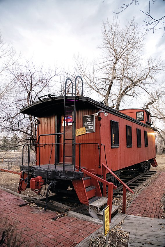 The Caboose Gallery at the Depot Art Gallery in downtown Littleton. Photographer Samuel Howard displays his art inside it.