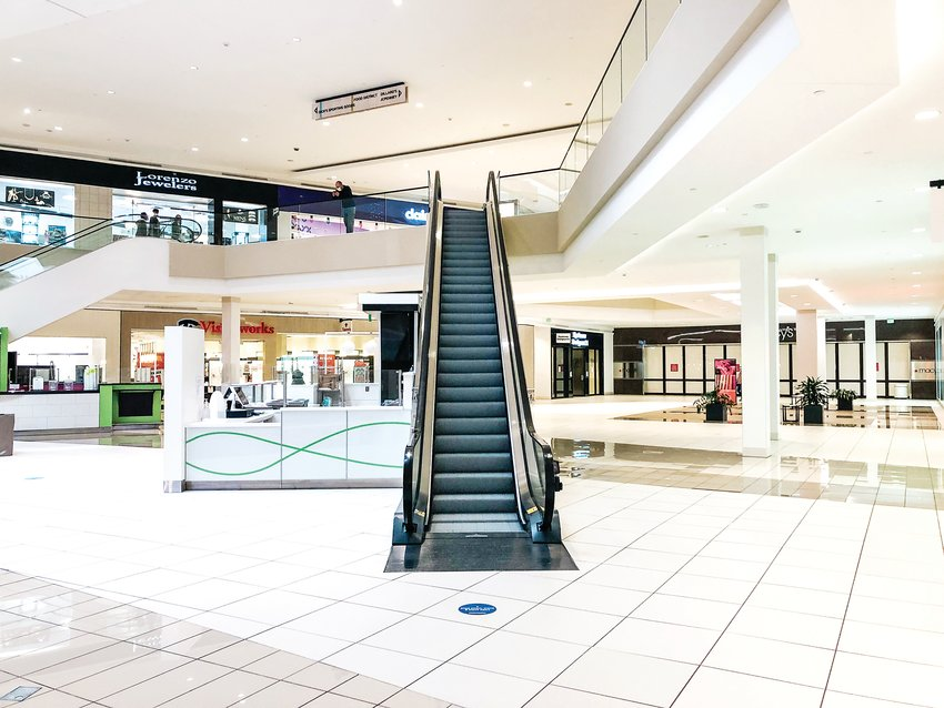 An empty escalator at Southwest Plaza mall in South Jeffco on Dec. 14.