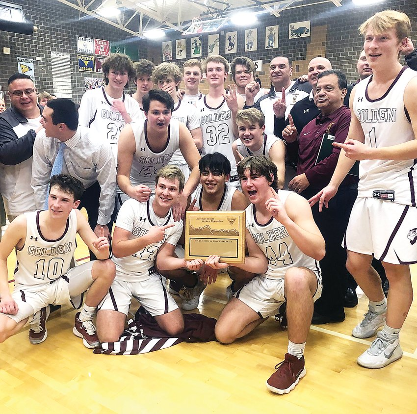 Golden basketball players proudly show off the 2020 Class 4A Jeffco League championship plaque after taking a 58-55 victory over rival Wheat Ridge on Feb. 21 at Golden High School.
