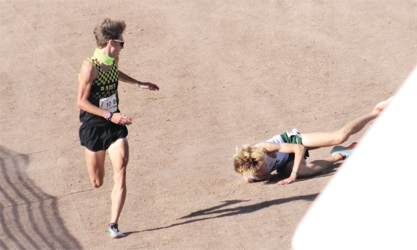 Green Mountain's Grahm Tuohy-Gaydos looks back at Niwot's Zane Bergen after a tumble at the finish line during the finish of the 4A boys state cross country race on Oct. 17. Tuohy-Gaydos was disqualified, giving Bergen the win in 15 minutes, 29.5 seconds.