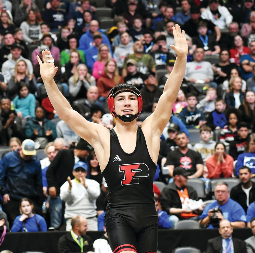 Pomona sophomore Daniel Cardenas celebrates after his pin of Poudre senior Dean Nobel to win the Class 5A 138-pound title Feb. 22 at Pepsi Center. It's the second individual state title for Cardenas who is now halfway to joining Colorado's 4-time state championship club.