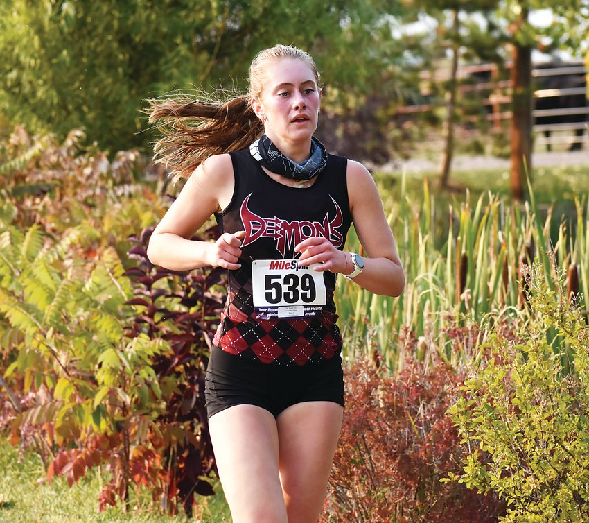 Golden sophomore Lily Mourer finished second to help the Demons to the girls Class 4A Jeffco League team title.