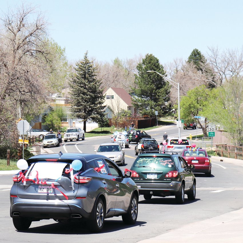 Thomson Elementary staff members drive through the school's neighborhood to see their students from afar during a May 7 celebratory parade.