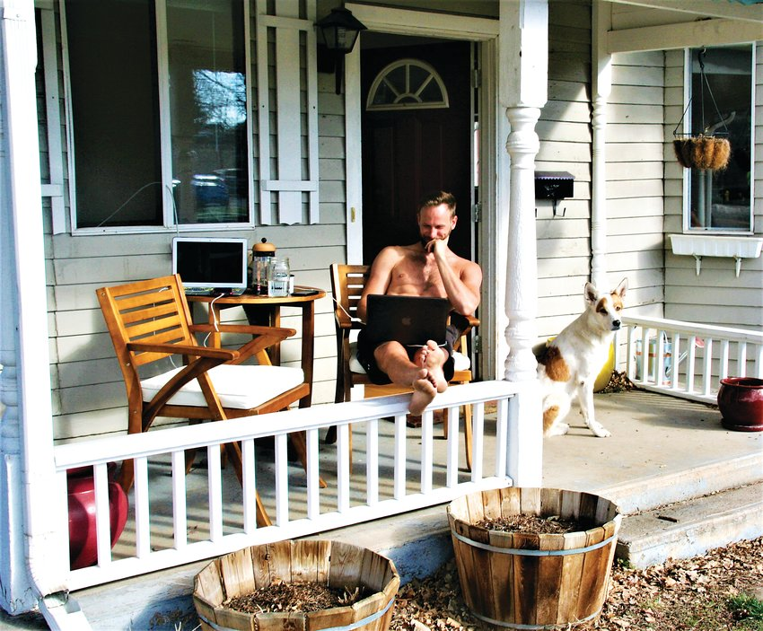 "Graham Hartle ""works from home"" while sitting on his porch at 1019 10th Street in Golden following the spring statewide stay-at-home order."