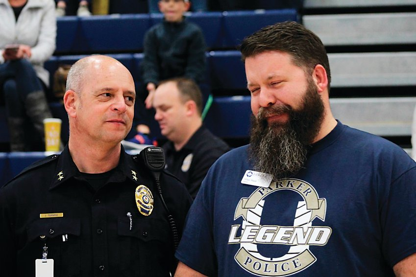 Mike Waid, right, chats with Jim Tsurapas, who was then interim chief of Parker police and is now the department's chief, during a Unified basketball game in February 2020 at Legend High School.