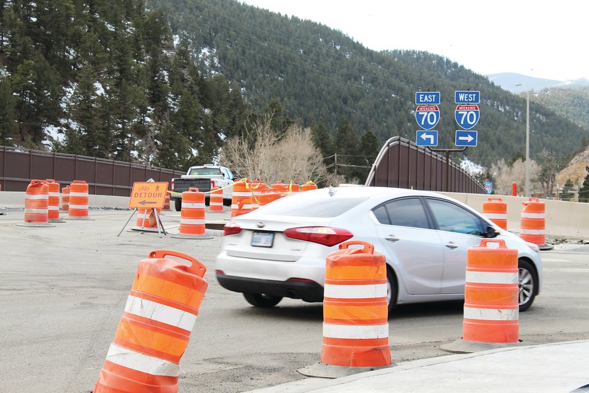 Traffic passes through Interstate 70's exit 240 intersection, which is under construction to improve safety and traffic flow as part of the westbound mountain express lane project.