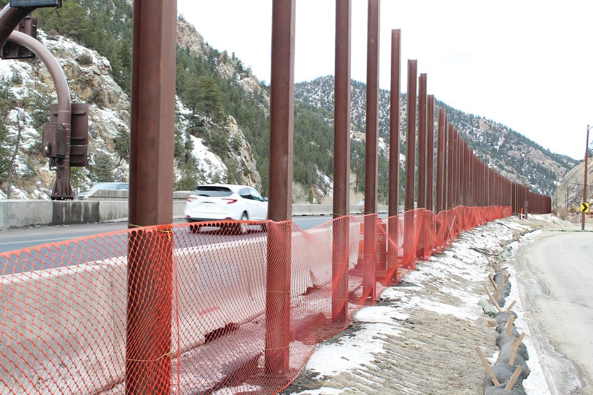 The sound wall between westbound Interstate 70 and the 100 block of Miner Street stands uncompleted Thursday morning. The sound wall is among several items that will be completed this winter and spring for the westbound mountain express lane project.