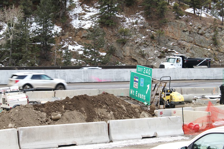 Interstate 70 traffic passes by the exit 240 sign's temporary location Thursday while the area is under construction for the mountain express lane project.