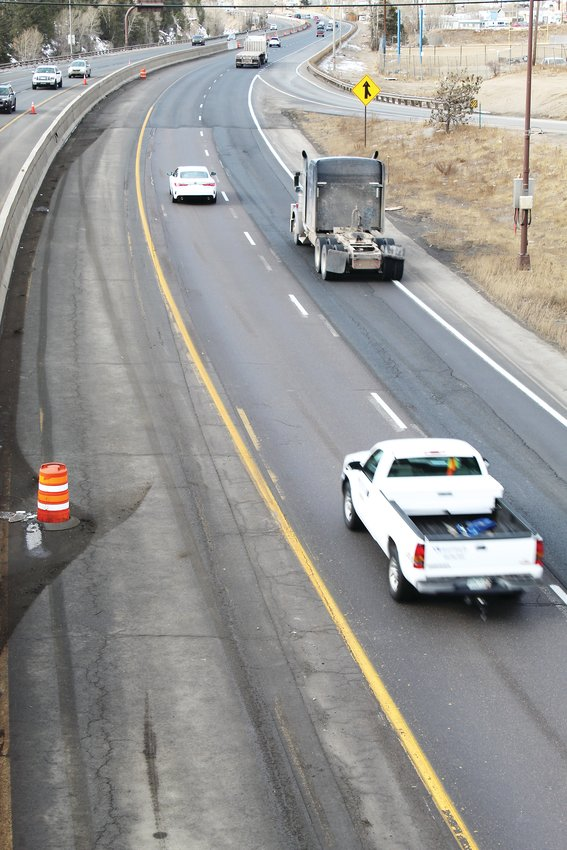 Westbound Interstate 70 traffic passes the forthcoming mountain express lane, which the Colorado Department of Transportation hopes to open for testing this spring or early summer.