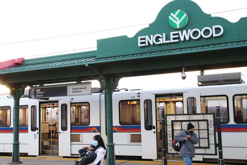 "Passengers depart a train at the Englewood light rail station on Jan. 16. A short walk away, the city may build a pedestrian bridge over Santa Fe Drive in the coming years, according to Englewood's 2021 budget. It's intended to ""provide a direct connection to the South Platte River Trail"" from the light rail station and ""enhance connections to the redeveloping central portion of the community from the west,"" the budget document says."