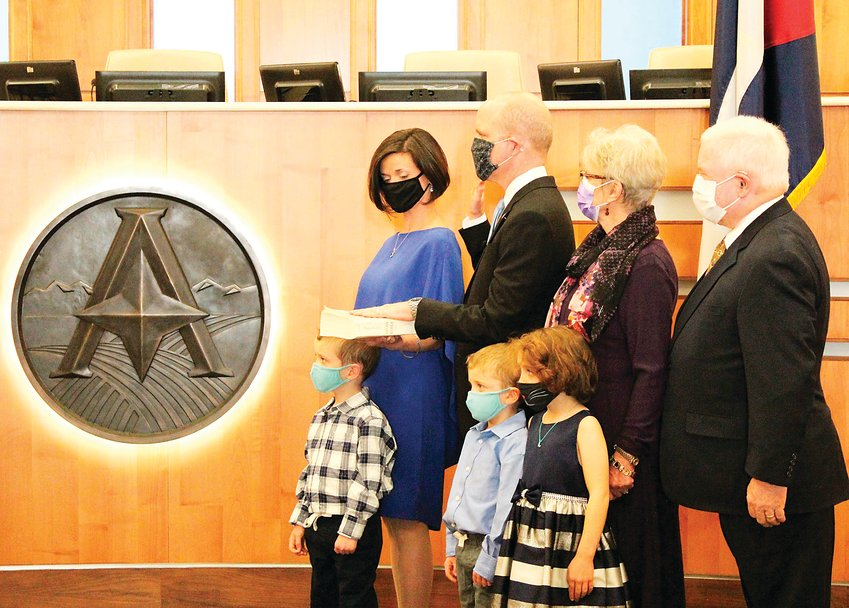 District Attorney Brian Mason takes the oath with his family beside him Jan. 12 from Chief Judge Don Quick.