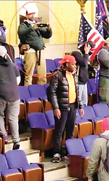A photo taken inside the insurrection at the U.S. Capitol on Jan. 6 allegedly shows Patrick Montgomery, a Roxborough-area man, according to an affidavit filed in federal court.