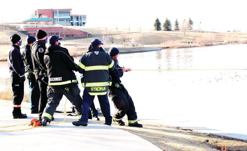 Thornton and Metro North fire crews pull the rope, helping one of their own rescue a weighted dummy, part of a joint training exercise between the Thornton department and the  North Metro Fire and Rescue District Jan. 19 at Thornton's Civic Center Park.