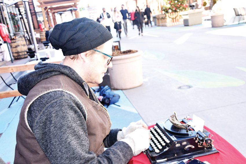 Devan Kingsford creating a poems for strangers on the mall.