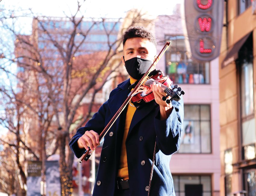 Ivory Sykes, aka Vio the Violinist, of Aurora performs near Welton Street on the 16th Street Mall in Denver on Jan. 16. Skyes regularly performs at the mall on weekends, though his appearances were less often in 2020 because of the COVID-19 pandemic, he said. Sykes' music can also be found on all major social media outlets with the handle viotheviolinist.