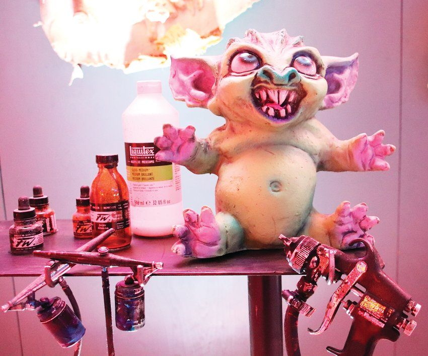 Some of the displays at Distortions Monster World include props and an accompanying video that gives visitors a behind-the-scenes look at creating the monsters.