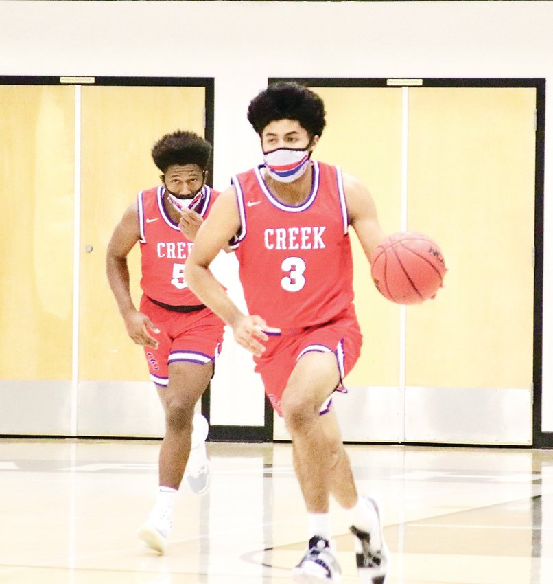 Cherry Creek's Julian Hammond III (3) wears a mask which is required for all players this season. Cherry Creek defeated Arapahoe, 79-60, in the Centennial League opener played Jan. 27 at Arapahoe.