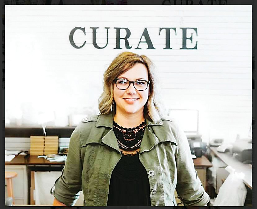 Karli Millspaugh, owner of Curate Mercantile and Maker's Market, stands for a portrait.