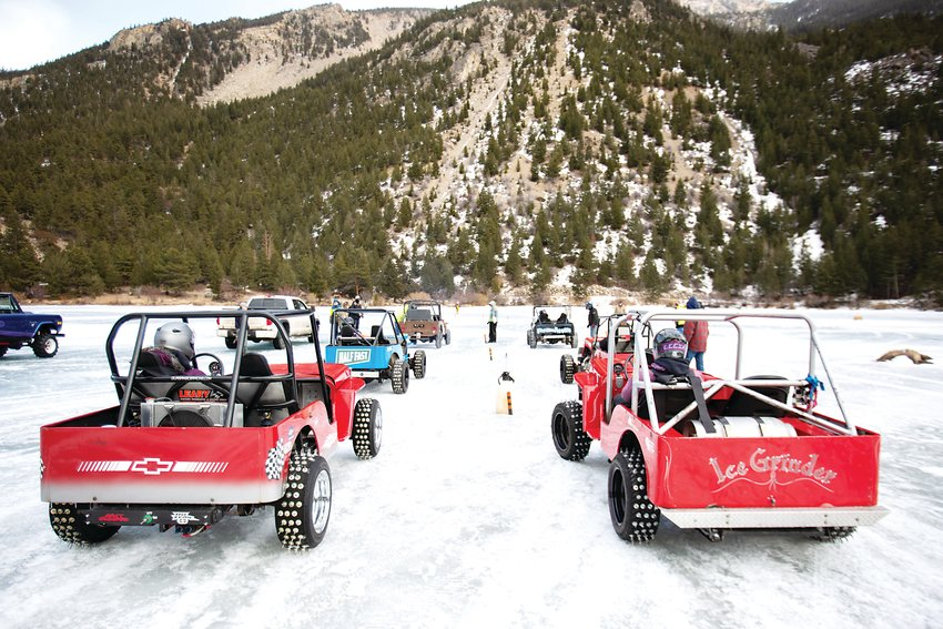 "For Saturday's final event of the day, competitors line up on Georgetown Lake using their ""cheater"" tires, consisting of a series of rows with long metal spikes that slice through the ice and provide better traction for faster race times."