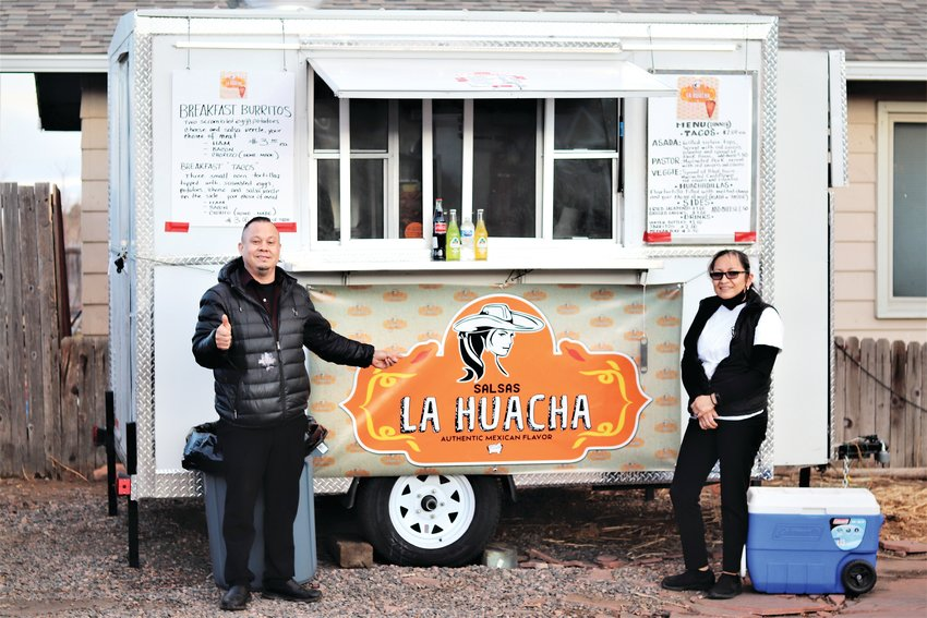 Edna Guzman and Francisco Estrada stand outside their new taco truck off of South Golden Road.