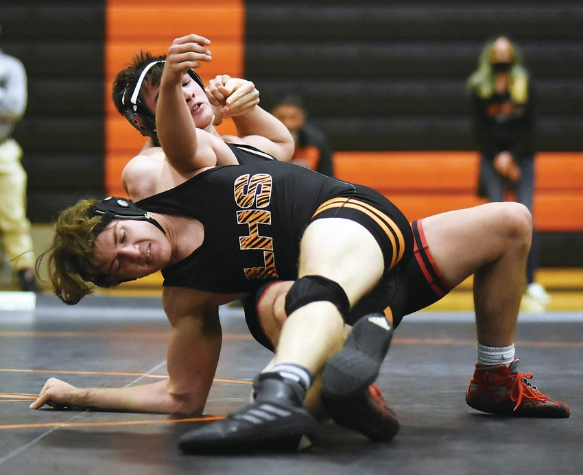 Pomona junior Jacob Judd, behind, works on getting back points during his 170-pound match against Lakewood senior Nolan Hoefner on Feb. 4. The No. 1-ranked Panthers got dual victories over Lakewood and Standley Lake.