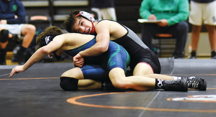 Pomona sophomore Jakob Romero, top, controls his match with Standley Lake sophomore Aidan Carlin on Feb. 4 at Lakewood High School. The Panthers currently have 11 wrestlers ranked in the top-5 in their individual weight classes.