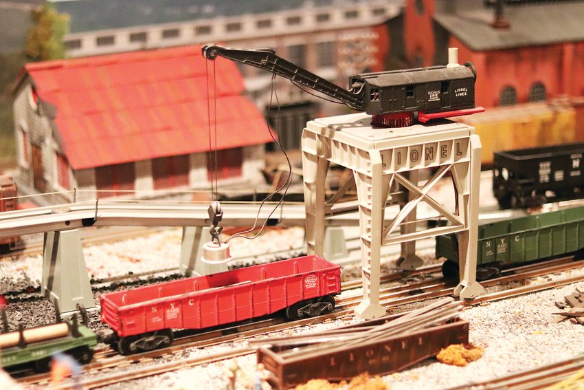 Many of Ken Cook's train layout's accessories come to life, like this miniature magnetic crane.