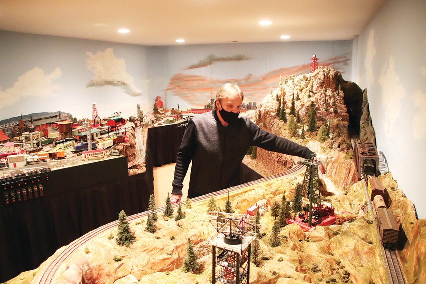Ken Cook stands in the midst of his sprawling Lionel train layout, the culmination of decades of collecting and 30 years of planning.