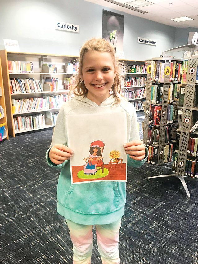 Abiyana Holmes, a fifth-grader from Eldorado Elementary, proudly displays her drawing that is included in J.K. Rowling's book The Ickabog.