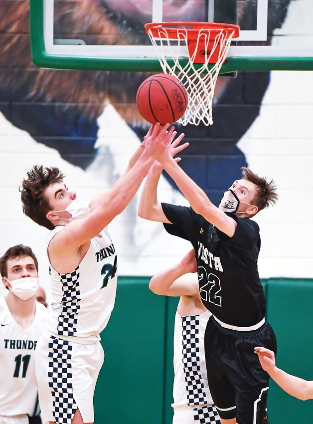 ThunderRidge's JJ Williams, left, and Mountain Vista's TY Strawbridge fight for the loose rebound. The very physical game, a matchup of teams both ranked in the top six in the state, saw four players foul out. ThunderRidge won 80-71.