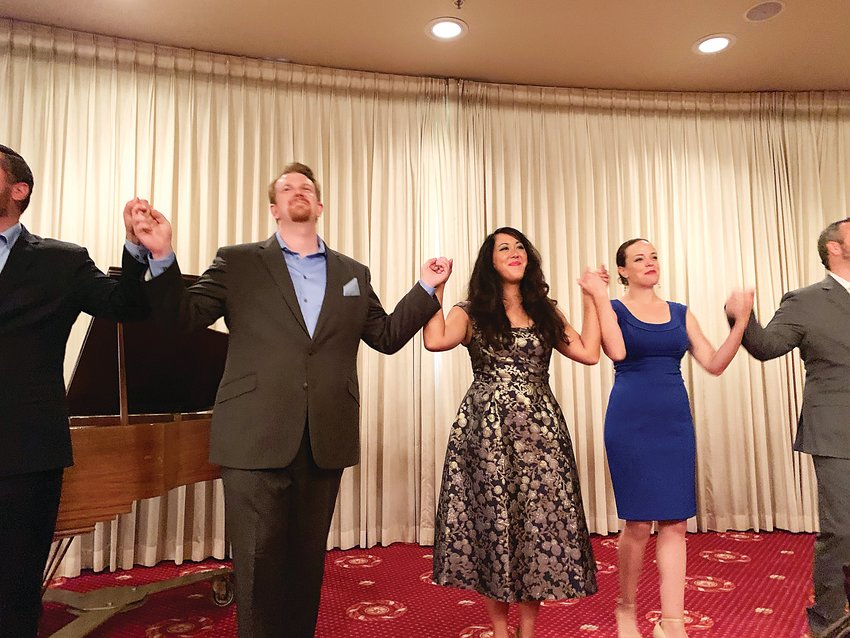 Young winners of a previous Denver Lyric Opera Guild competition sing for the guild members at a luncheon at Cherry Hills Country Club.
