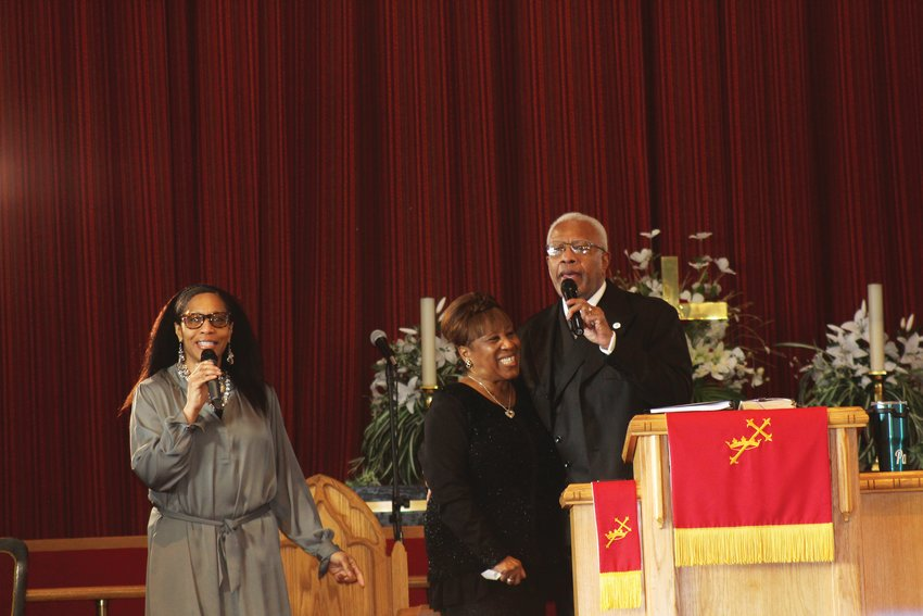 From left to right, Stacie Burleson, Dallas Burleson and Paul Burleson, singing at a Feb. 14 service at Friendship Baptist Church of Christ Jesus in Denver. The Burlesons credit Dallas' parents, George and Dorothy Johnson, with the church's formation.
