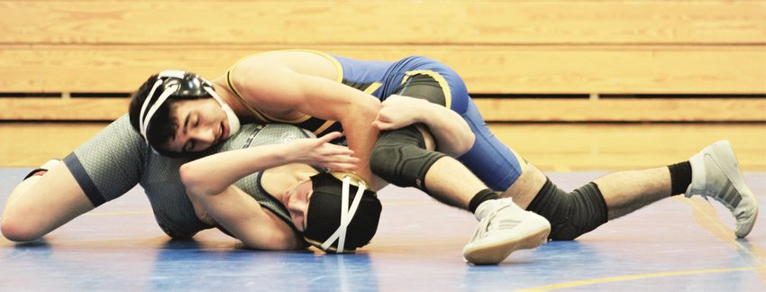 Wheat Ridge's Daunte Limon tries to put Evergreen's Reya Montano shoulders to the mat during their 126-pound bout on Thursday, Feb. 18.