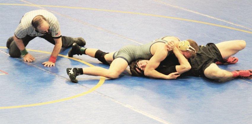 Evergreen's Gabe Benton pins Faith Christian's Austen Apperlee in 1 minute, 8 seconds on Thursday, Feb. 18 at Wheat Ridge High School.
