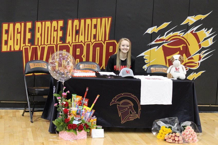 Eagle Ridge Academy's Macey Lauridson signs her NLI in the school's gymnasium