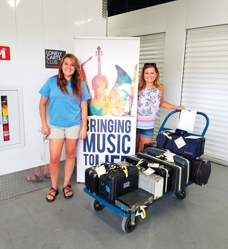 Music teacher Aleaha Harkins and art teacher Pam Jackson, who both teach at Denver Green School Southeast Campus in Denver's Virginia Vale neighborhood, pick up music instruments for student use during the 2020-2021 school year.