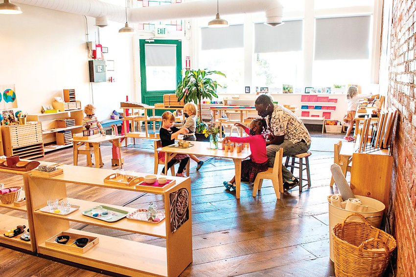 A teacher and children work on a lesson inside Echinacea Montessori School, which celebrated its one-year anniversary in February.