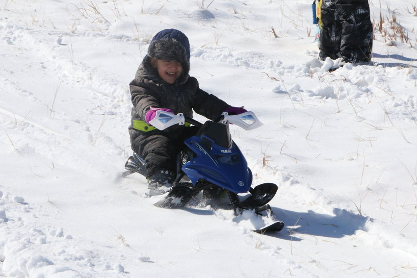 Three-year-old Nevin Schulthess rides in style, enjoying a snow day in Castle Rock.