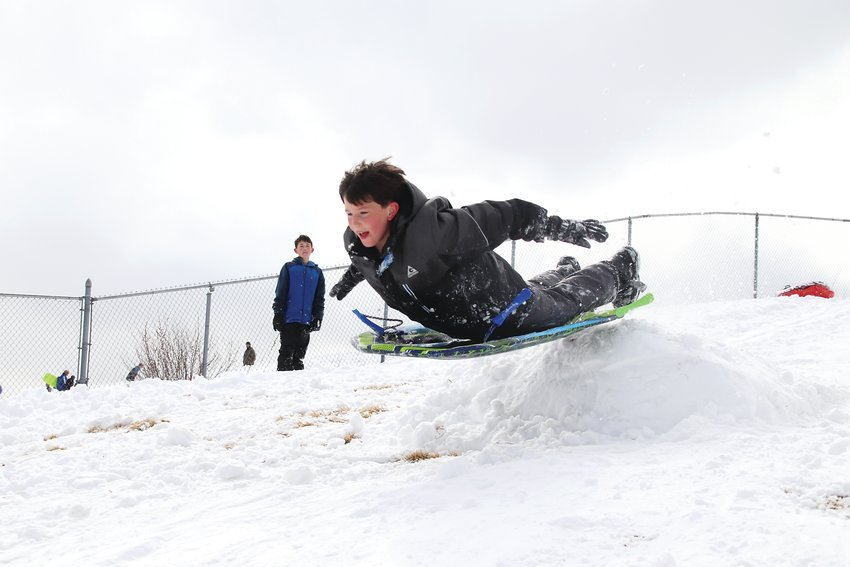 Eddie Pulsipher launches over a snow ramp at Goddard Middle School.